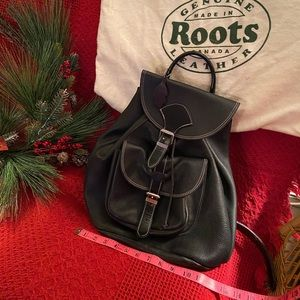 MAKE A OFFER Roots black leather backpack coin